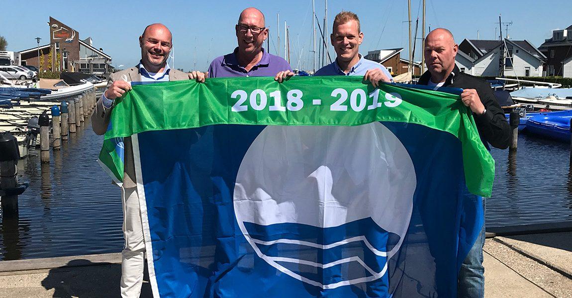 Acht Blauwe Vlaggen en een Groene Wimpel